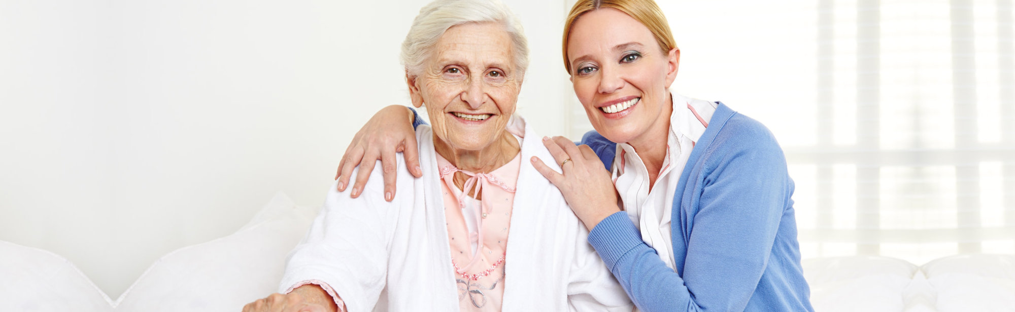 Smiling an old woman and his caregiver