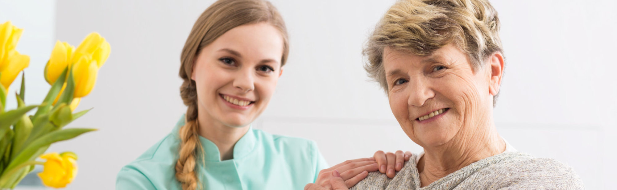 Smiling nurse and old woman